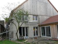 Un espace de détente dans un ancien corps de ferme